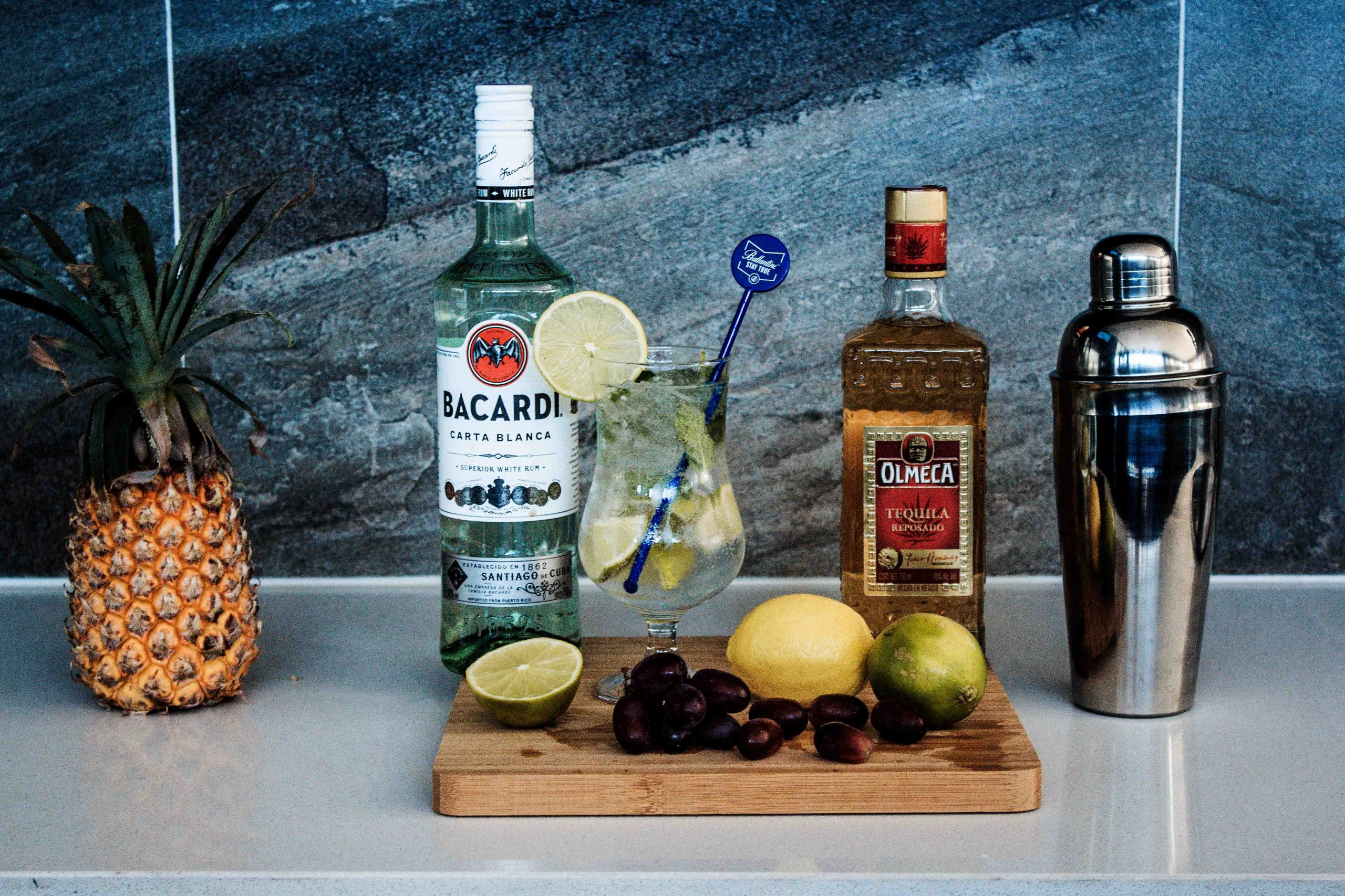 two-liquor-bottles-near-fruits-2360578