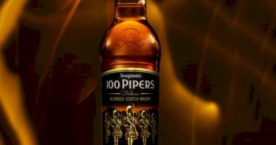 """100 pipers bottle in the center"">"