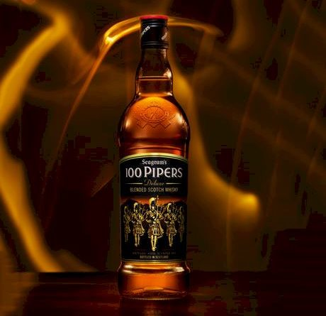 """""""100 pipers bottle in the center"""">"""