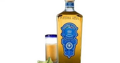 """A bottle of Piedra Azul Reposado with a lemon"">"