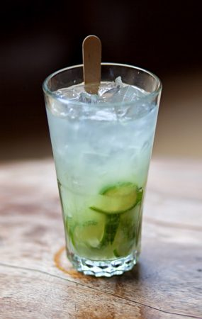 """Caipirinha drink with lemon and ice"">"