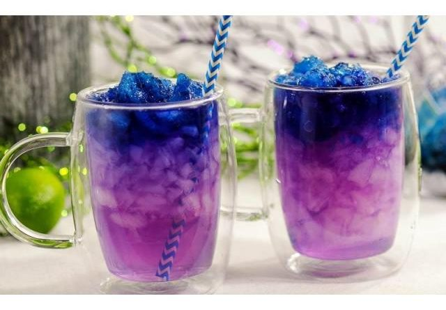 """galaxy cocktail with ice and straws"">"