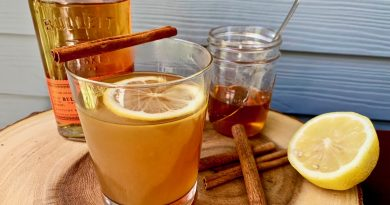 """Toddy drink with lemon and glasses to enjoy"">"