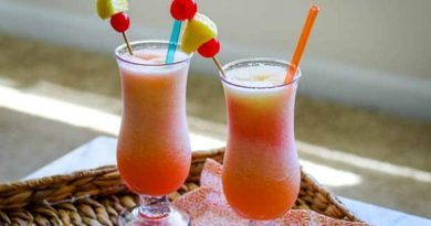 """Frozen bahama mama cocktail with straws"">"