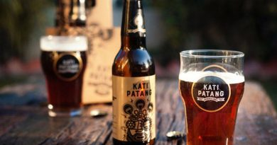 """Kati Patang beer with a glass."">"